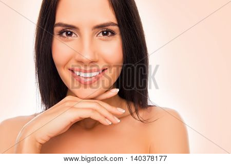 Portrait Of Pretty Young Woman With Beaming Smile Touching Chin