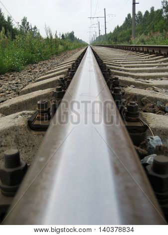 Low angle view of rail track sleepers close up industrial background