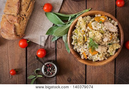 Tasty Pearl Barley Porridge With Vegetables And Chicken. Top View