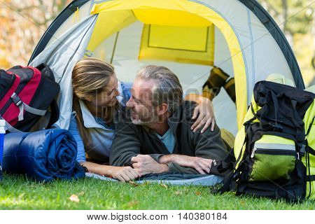 Hiker couple embracing each other in tent