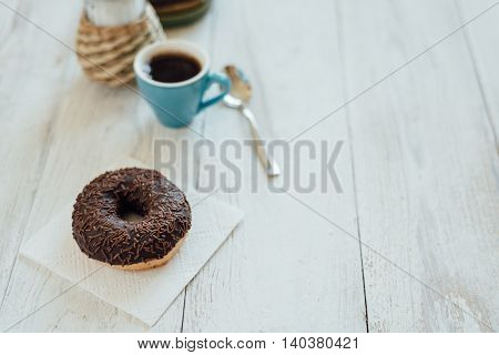 Breakfast In Cafe With Chocolate Donut And Coffee