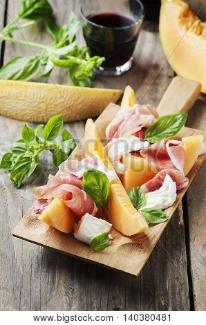 Antipasto With Melon, Mozzarella, Ham And Basil
