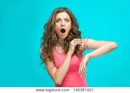 The portrait of young woman with shocked facial expression