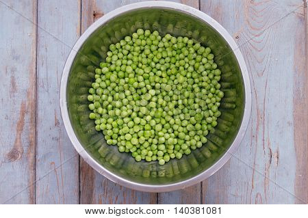 Peas In Metal Bowl On Wooden Background, Top View.