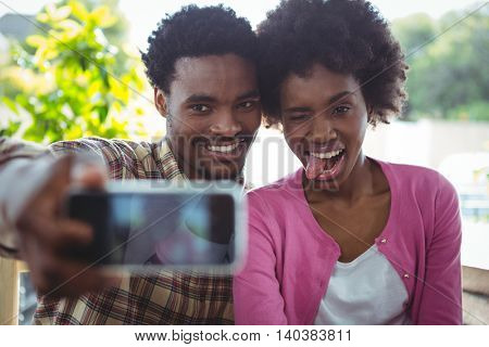 Happy young couple selfie in cafeteria