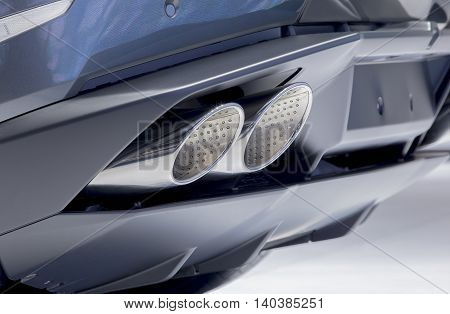 close up exhaust pipe of blue car