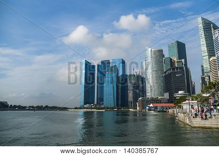 SINGAPORE - MAY 6 2016 : Cityscape of Singapore business district skyline near Marina Bay and Merlion Park.