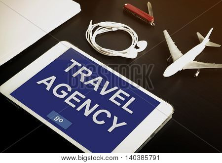 Online travel agency contact now on your Tablet or mobile devices. Travel agency website on tablet. Online travel booking website on tablet screen.