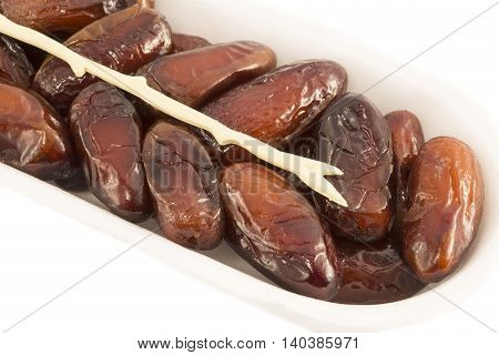 Dates in package isolated on white background