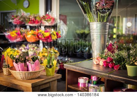 Plant pots and bouquet on table at flower shop