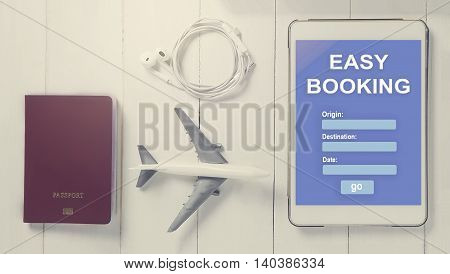 Online Travel booking on Tablet. Traveller using online travel agency to book plane ticket. Online hotel booking website template on tablet screen. Airline online reservation service on a tablet.
