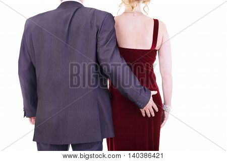 Male grabbing female buttocks sexual harassment concept.