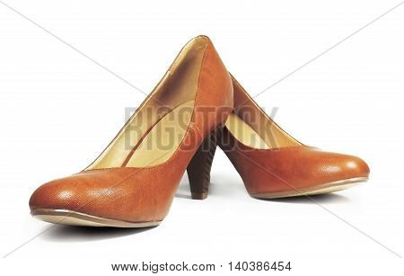Brown pumps, leather shoes, isolated on white background.