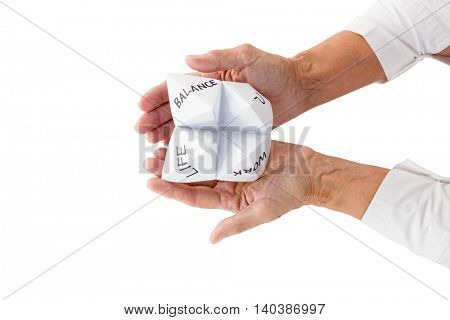 Cropped image of person holding origami fortune teller