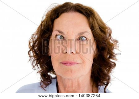 Close-up of cross-eyed woman against white background