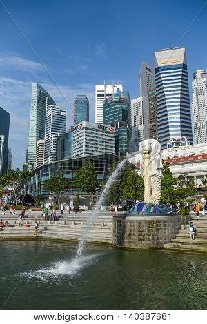 SINGAPORE - MAY 6 2016 : Tourists visit the Merlion Park a famous symbol and landmark of Singapore.