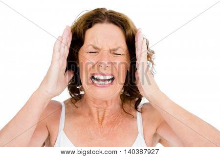 Close-up of mature woman shouting against white background