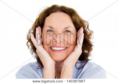 Close-up of smiling woman gesturing against white background