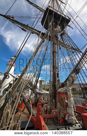 SYDNEY, AUSTRALIA - APRIL, 2016 : Carved head of sailor painted in fiery orange red and rigging ropes at foredeck of Tall Ship HMB Endeavour at Darling Harbour in Sydney, Australia on April 21, 2016