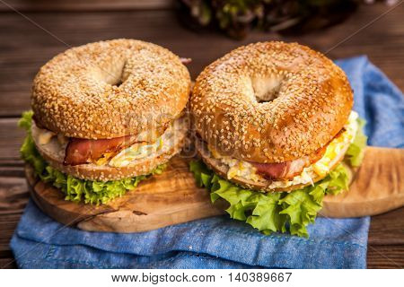 Bagel with bacon and egg for breakfast