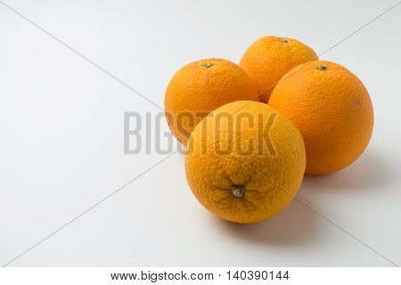 four orange on the plate on white background