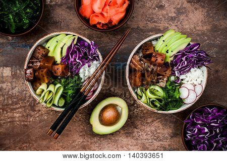Hawaiian tuna poke bowl with seaweed avocado red cabbage radishes and black sesame seeds