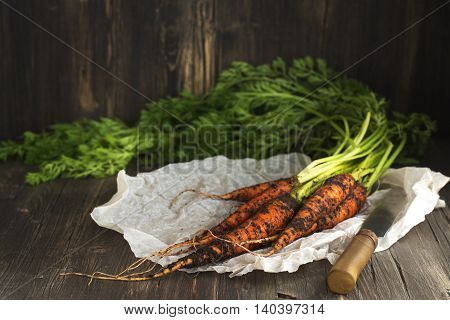 Bunch of fresh organic carrot over vintage wooden table
