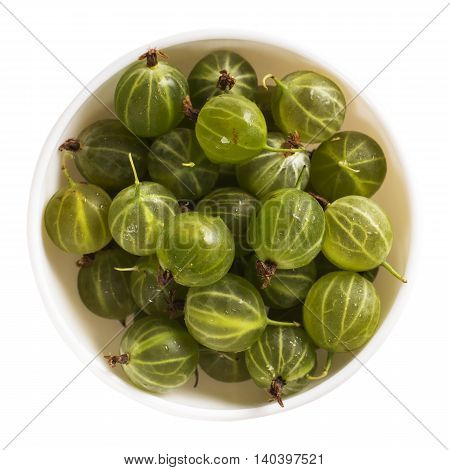 Bowl of green gooseberry isolated on white background. Top view