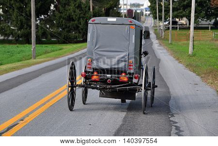 Lancaster County Pennsylvania - October 13 2015: An Amish buggy driving along Route 772 near the town of Intercourse