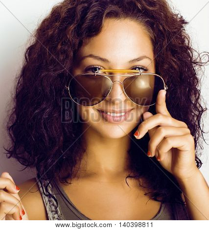 portrait of happy funny teenage girl with sunglasses isolated