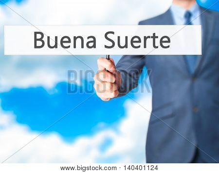 Buena Suerte ( Good Luck In Spanish) - Business Man Showing Sign