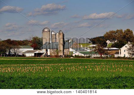 Lancaster County Pennsylvania - Ocrober 15 2015: Amish farm complex with farmhouse barns and silos
