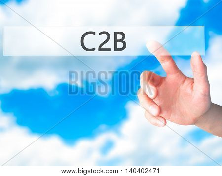 C2B - Hand Pressing A Button On Blurred Background Concept On Visual Screen.