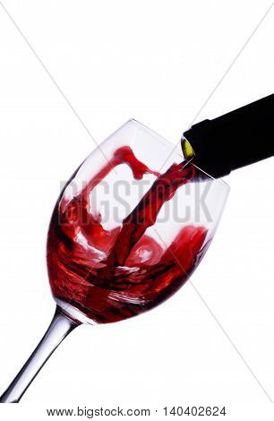 Bottle and wine glass in white background