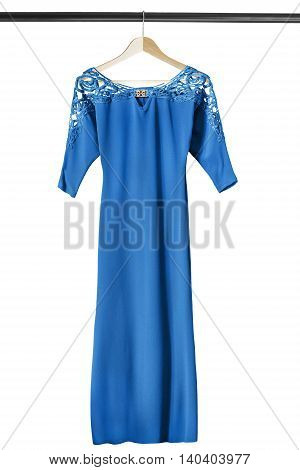 Blue silk lacy gown on wooden clothes rack isolated over white