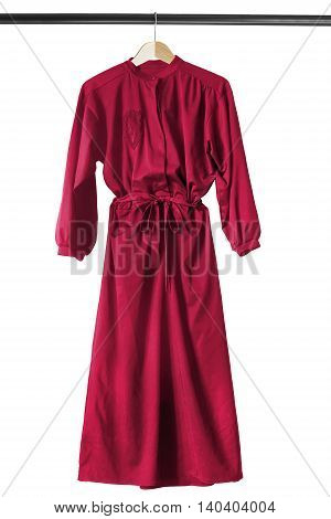 Red silk dress on wooden clothes rack isolated over white