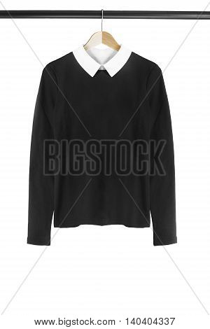 Black pullover on wooden clothes rack isolated over white