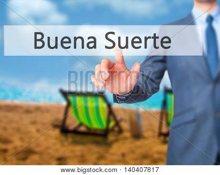 Buena Suerte ( Good Luck In Spanish) -  Businessman Click On Virtual Touchscreen.