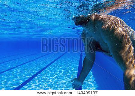 Young beard man alone in swimming pool Underwater Man with Beard Underwater swimming pool