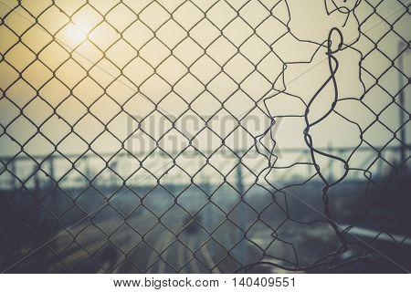 Mesh Fence With Sunrise