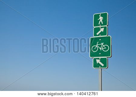 Beach directional bike path and walking sign