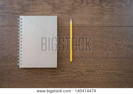 Notebook With Pencil On Office Wooden Table