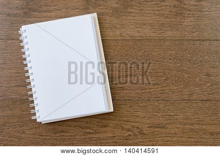Blank White Notebook On Wooden Texture Background