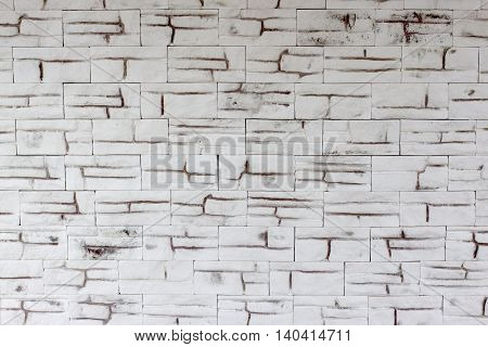 Background from a white with brown stone masonry
