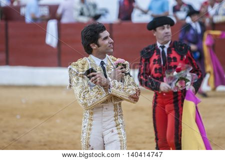 Sabiote SPAIN - Sptember 9 2011: The Spanish Bullfighter Cayetano Rivera greeting the public with its cap in the hand in gratitude to its bullfight in the Bullring of Sabiote Spain