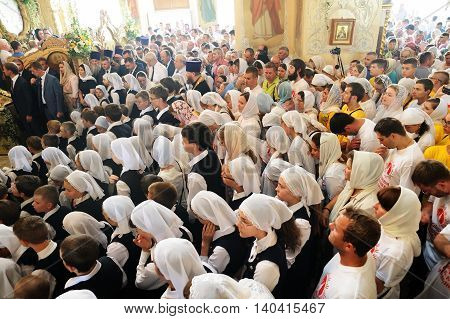 Orel Russia - July 28 2016: Russia baptism anniversary Divine Lutirgy. Girls in white shawls waiting for holy communion above