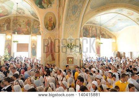 Orel Russia - July 28 2016: Russia baptism anniversary Divine Lutirgy. Crowd of parisioners waiting for holy communion in orthodox church