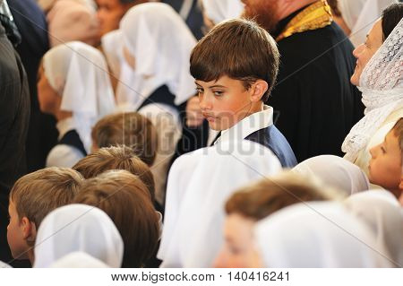 Orel Russia - July 28 2016: Russia baptism anniversary Divine Lutirgy. Boy among girls in white kerchieves selective focus