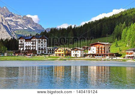 MISURINA ITALY - JULY 12: View of Misurina lake in Veneto Italy on July 12 2014. Misurina is a famous lake in Dolomites province Veneto Italy.