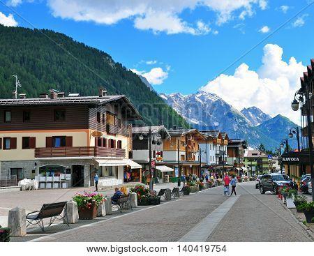 MADONNA DI CAMPIGLIO ITALY - JULY 11: View of the main pedestrian street in Madonna di Campiglia Italy on July 11 2014. Madonna di Campiglia is a ski resort in Dolomites Alps Italy.
